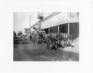 Primary view of object titled '[Wagon in front of store]'.