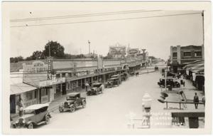 Primary view of object titled '[Main street in Nuevo Laredo, Tamaulipas]'.