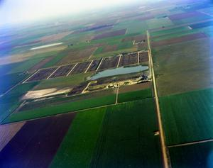 Primary view of object titled '[Aerial Photograph of Fields and Feed Yards in Deaf Smith County]'.