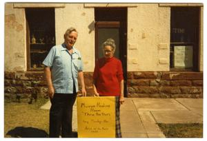 James Lovelady and Nora Bell Munn in front of Clark Hotel Museum