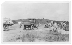 Primary view of object titled '[Men Filling Sand Bags]'.