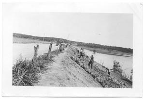 Primary view of object titled '[Placing Riprap on Fishtrap Road]'.