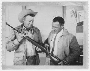 "Tolbert Bell and H.O. ""Hock"" Haynes with rifle"