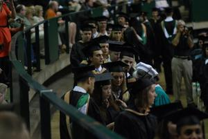 Primary view of object titled '[Students at Masters Commencement Ceremony]'.