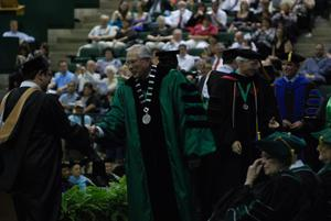 Primary view of object titled '[Student at Masters Commencement Ceremony]'.
