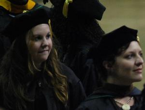 Primary view of object titled '[Two Students at Masters Commencement Ceremony]'.