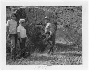 Primary view of object titled 'Charlie and Dessie McLure and Van Foster by petroglyphs'.