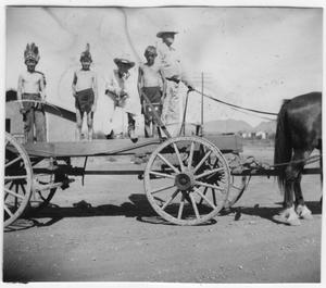 Primary view of object titled 'Allen Hall on wagon with children dressed as Indians'.