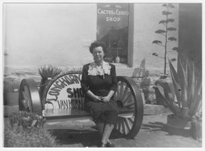 Primary view of object titled 'Mrs. Fred (Mabel) Clark outside Clark Hotel'.