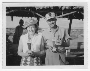 Primary view of object titled 'Audrey Synder and Jack Watts with Golf Trophies'.