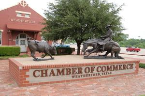 Primary view of object titled 'Weatherford Texas Chamber of Commerce Building and Statues'.