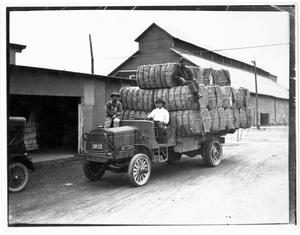 Primary view of object titled 'Cotton Bales on Truck'.