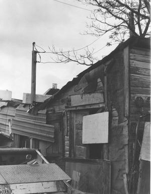 Primary view of object titled 'Home in Disrepair in Southeast Fort Worth'.