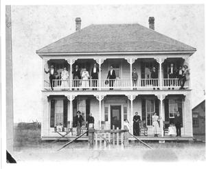 Primary view of object titled 'People on Porches of Two-Story Home'.