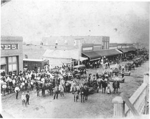 Primary view of object titled 'Wagons Passing Down Main Street'.