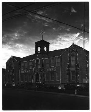 Primary view of object titled '[City of Denton: City Hall, N. Elm decorated for Christmas]'.