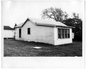 Primary view of object titled 'Exterior View of Back of a White House'.
