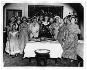 Primary view of object titled 'Costumed Women With Punch Bowl'.