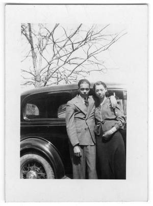 Primary view of object titled '[Portrait of an Unidentified Man and Woman in Front of a Car]'.