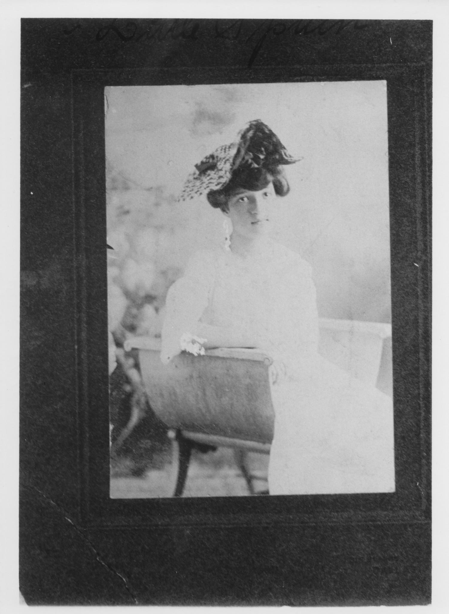 Woman Seated in Curved Chair                                                                                                      [Sequence #]: 1 of 1