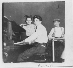 Primary view of object titled 'Children around a Piano'.