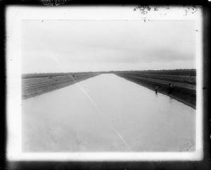 Primary view of object titled '[Dirt Canal with Two People]'.