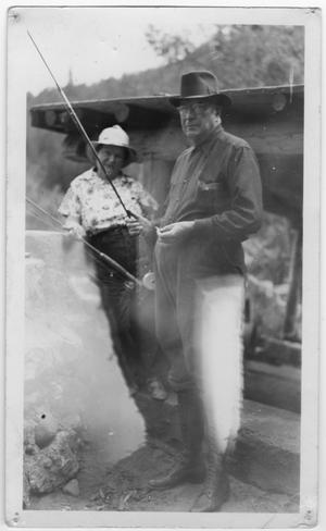 Primary view of object titled '[Col. Hugh B. Moore and Helen Edmunds Moore fishing]'.