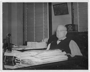 Primary view of object titled '[Col. Hugh B. Moore in his office]'.