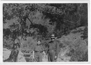 Primary view of object titled '[Col. Hugh B. and Helen Moore taking a walk]'.