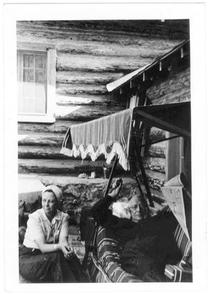 Primary view of object titled '[Col. Hugh B. Moore relaxing at the cabin in New Mexico]'.