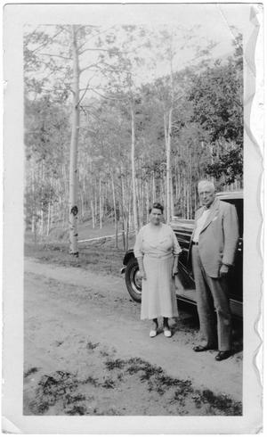 [Col. Hugh B. and Helen Moore standing on a road near Santa Fe, New Mexico]