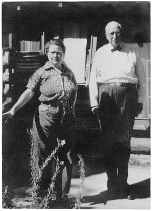 Primary view of object titled '[Col. Hugh B. and Helen Moore in front of their cabin in New Mexico]'.