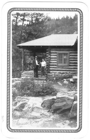 Primary view of object titled '[Col. Hugh B. and Helen Moore on the porch steps of their cabin in New Mexico]'.