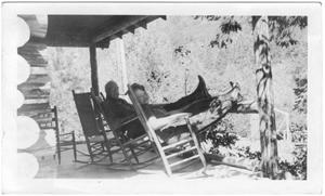 Primary view of object titled '[Col. Hugh B. and Helen Moore relaxing on the porch of their ranch]'.