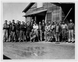 Primary view of object titled '[American Oil Company workers in 1934]'.