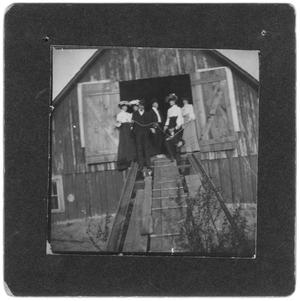 Primary view of object titled 'Men and Women Standing in a Barn Doorway'.