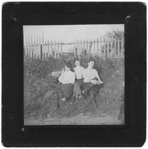 Primary view of object titled 'Three Women Sitting by the Side of the Road, Smoking Cigars'.