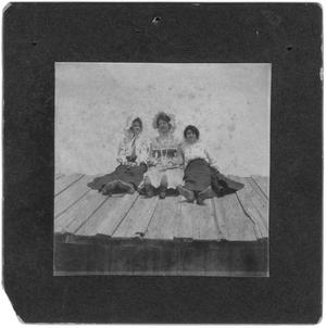 Primary view of object titled 'Three Women Sitting on a Barn Roof'.