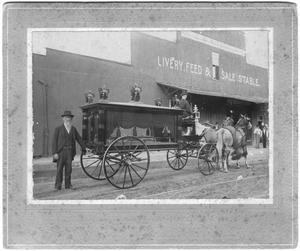Primary view of object titled 'J.P. Crouch with Hearse, at C. R. Ritenour, Livery, Feed & Sale Store'.