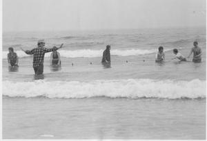 Primary view of object titled 'Geology Students Standing in the Ocean Waters'.