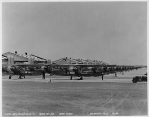 Primary view of object titled 'Ships on Line - Basic Stage [Planes Lined Up in Front of Hangars]'.