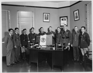 Primary view of object titled 'American and Mexican Air Force Officials Holding Mexican Air Force Flag'.