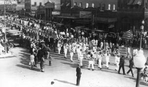 Primary view of object titled '[Parade in Downtown Taylor]'.