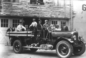 Primary view of object titled '[Georgetown Firemen on Firetruck]'.