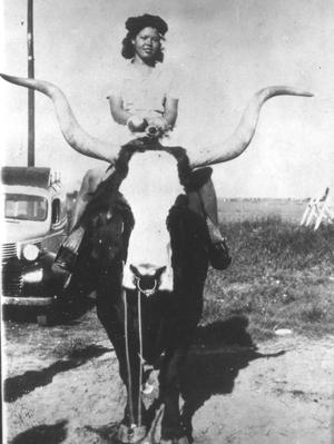 Primary view of object titled '[Woman Sitting on a Longhorn]'.