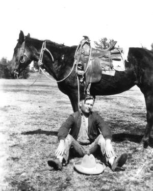 Primary view of object titled '[Bethel Baker Sitting with a Saddled Horse]'.