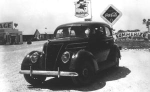 Primary view of object titled '[Car Parked on a Street in Jarrell]'.