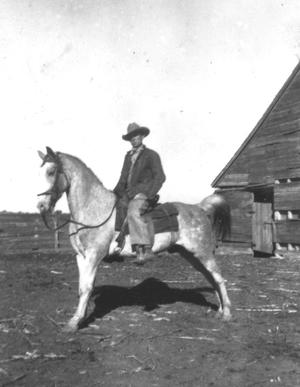 Primary view of object titled '[Louis Kruger on horse]'.