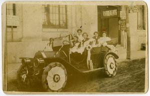 Primary view of object titled '[Women in a Decorated Car]'.