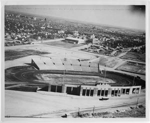 Side aerial view of a football field partially in construction.